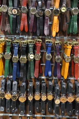 Group of unisex watches on the wall photo