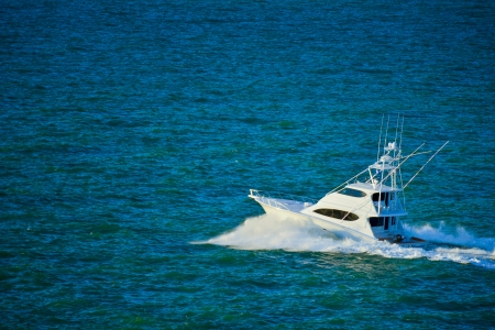 White boat floating in the waves Stock Photo