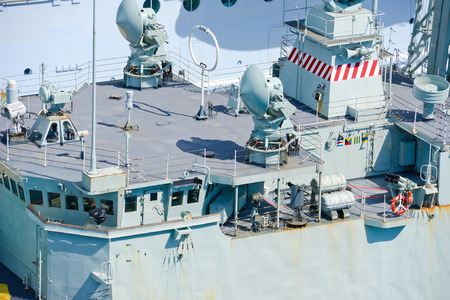 Military ship docked in a port
