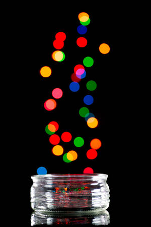 Jar in black background and colorful bokeh photo
