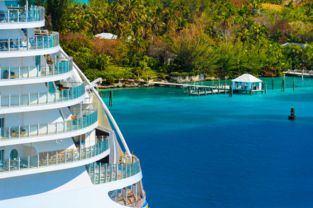 cruise ship: Side of a cruise ship with trees and ocean in background