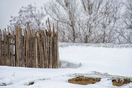 Fence and snow in Romania   photo