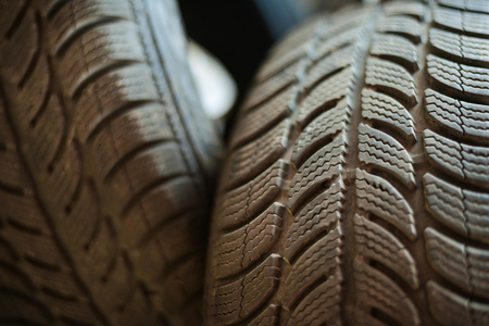 Used car tires in a warehouse in natural light photo