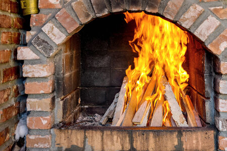burning time: Wood burning in a barbecue in winter time Stock Photo