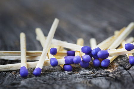 A lot of matchstick on a textured wood background Stock Photo