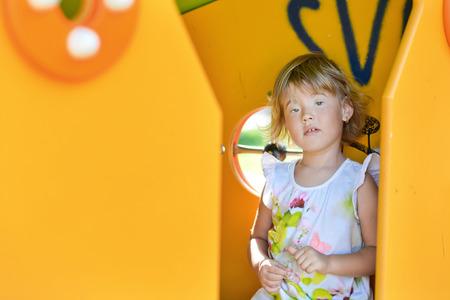 giggling: Giggling girl enjoys the playground