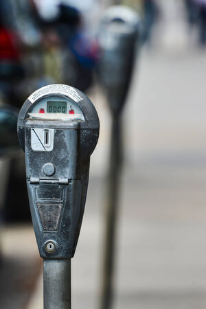 Gray parking meter in use in London, UK photo