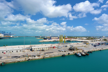 freeport: Industrial view in Freeport - Bahamas  A lot of ships and cranes ready for work