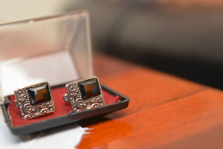 Silver Cufflinks placed in a plastic black box photo