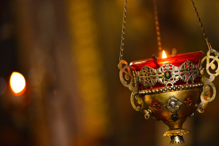 hope background: Candle flame, covered with gold religious in atmosphere of the church Stock Photo