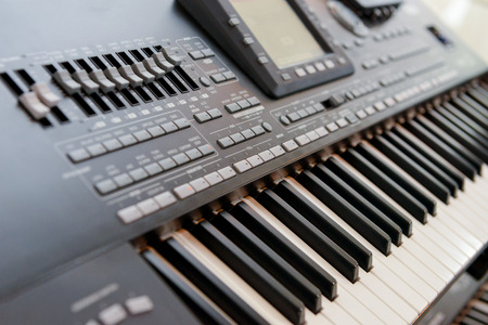 keyboard instrument: Electronic organ with many buttons and digital display Stock Photo