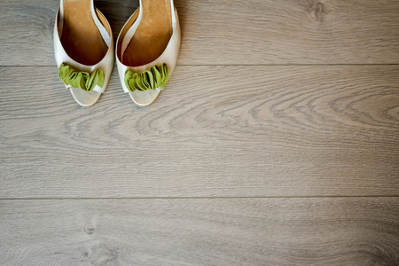 lamellar: Wedding shoes sitting on the floor lamellar