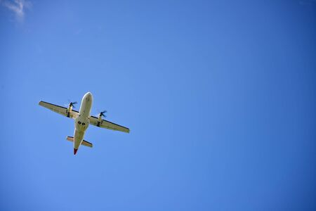 Propeller airplane flying in the sky