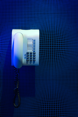important phone call: White phone on textured wall Stock Photo
