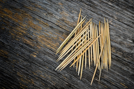 heathcare: Bunch of toothpicks on wooden background Stock Photo