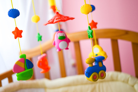 Children toys hanging from the crib