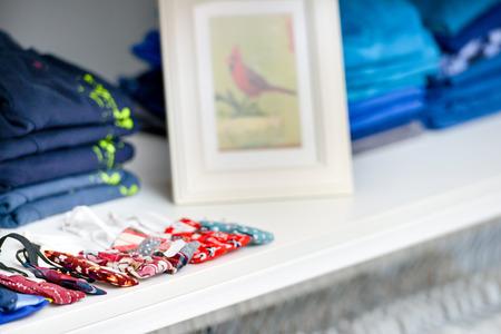 Shelf with folded shirts photo