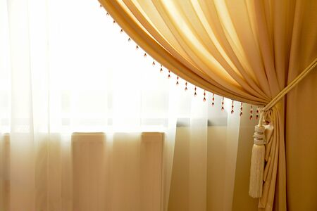 window curtain: Beige window curtain with crystals