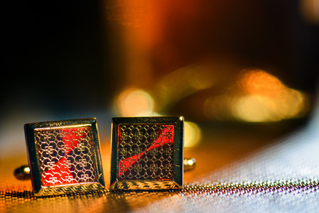 cufflinks: Isolated golden cufflinks