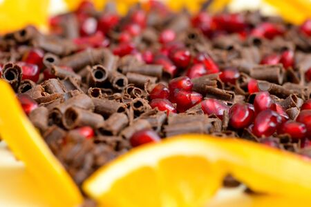 choco chips: Closeup of milk chocolate chips and pomegranate mix
