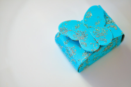 sparkled: Blue gift box with sparkling butterfly Stock Photo