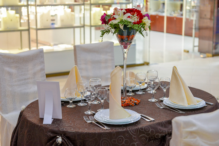Wedding table arranged with bunch of flowers