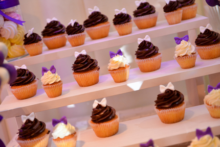 the shelf: Different type of cupcakes on a shelf