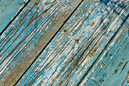 exfoliate: Blue fence with stripes in natural light Stock Photo