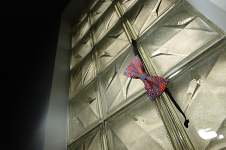 hanged: Bow tie with different shape hanged to the glass wall