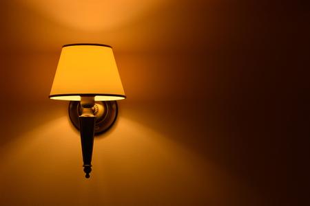 lit lamp: Hanging lamp lit wall in natural light