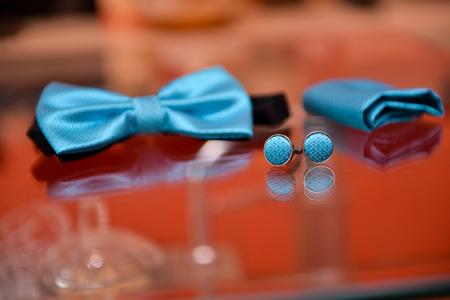 cufflinks: Blue bow tie and cufflinks reflective wedding day