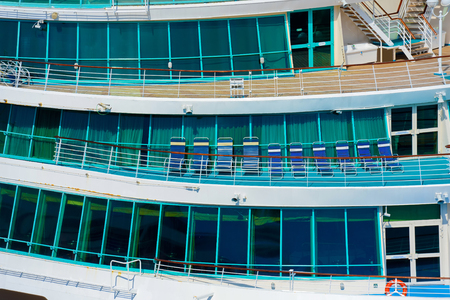 stateroom: Side of a cruise ship with balcony in natural light