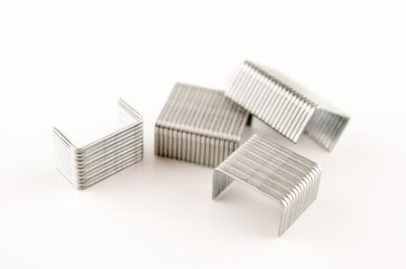 staple: Four staple stapler in white background