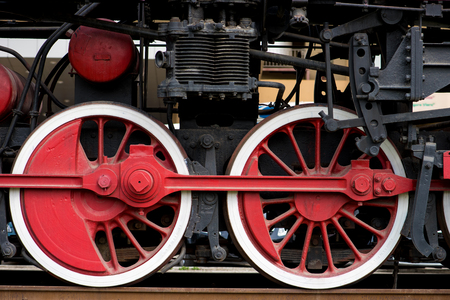 railway history: Wheels on a old train from the side Stock Photo