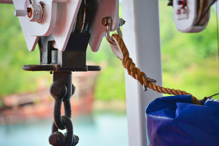 winch: Boat winch with rope in natural light Stock Photo