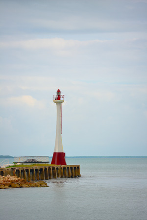 zeeland: Red lighthouse on a cloudy day