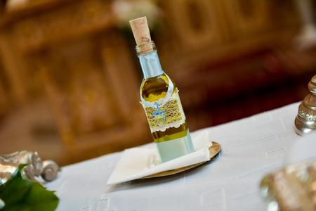 baptized: Bottle with oil for christening Stock Photo