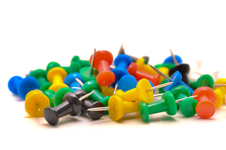 Thumbtacks on the table in natural light Stock Photo