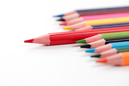 Colored pencils arranged on the table in natural light