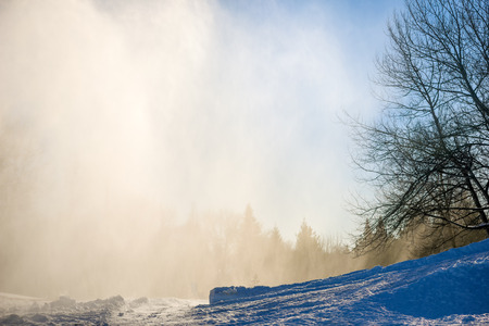 trickle down: Artificial snow on the piste in natural light