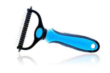 Professional pet grooming tools isolated on white