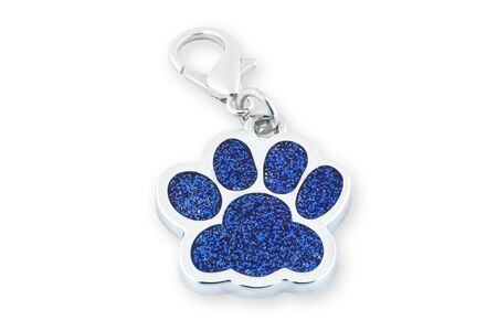 Closeup dog collar metal tag shaped in form footprint isolated on white background. Footprint clip collar accessory, leash charm footprint accessory, ID tag animal.