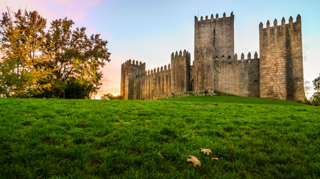 Guimarães, Portugal - November 23, 2014: End of a sunny day in the autumn next to the castle of Guimarães Editorial