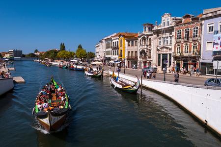 Aveiro, Portugal - September 01, 2017: Moliceiro boat strolling tourists through the ria of Aveiro, Portugal. Editorial