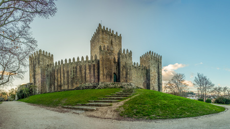 Guimaraes, Portugal - January 4, 2018: End of a sunny day in the Winter next to the castle of Guimar?es, Portugal