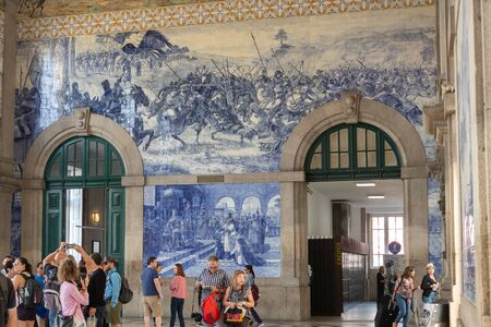 Porto, Portugal - September 16, 2018 : Porto S. Bento Station was built at the beginning of the 9th century decorated with more than 20,000 tiles, visited daily by hundreds of tourists, Portugal