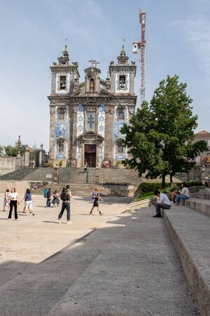 Porto, Portugal - September 16, 2018: Pilgrims and tourists visiting the Church of Santo Ildefonso, which is located in Pra?a da Batalha, parish of Santo Ildefonso, in the center of the city, Portugal