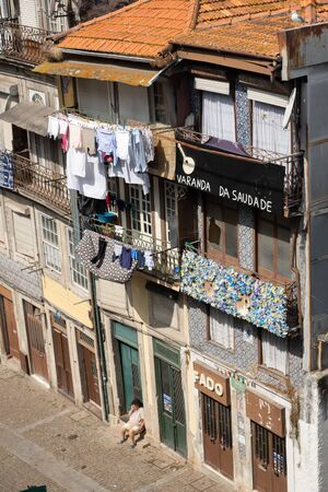 Porto, Portugal - September 16, 2018 : Balcony of homesickness written on the facade of one of the houses of the street Escura in the city of Porto, Portugal Sajtókép