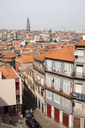 Porto, Portugal - September 16, 2018: Rooftops of the city of Porto and the wonderful Cl?rigos Tower in the background, Porto Portugal