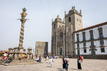 Porto, Portugal - September 16, 2018 : Busy afternoon together The Oporto Cathedral, located in the heart of Oportos historic center, is one of the oldest and most important monuments in Portugal.